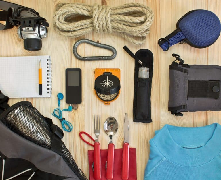 camping gear arranged and staged neatly on a table